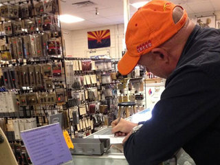 mark-kelly-buying-gun_1363196455159.jpg