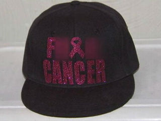 Sisters asked to leave over cancer hats