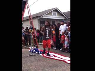 WATCH: Lil Wayne walks on American flag