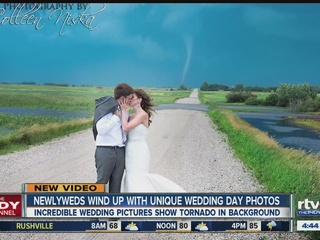 WOW! Tornado forms behind couple on wedding day