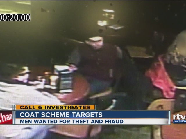 Men stealing wallets from purses using jackets