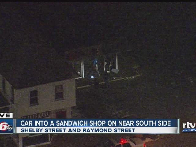 Car backs into sandwich shop on south side