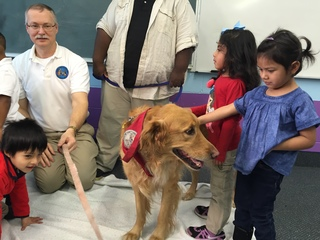 PHOTOS: Therapy dogs visit Indy Junior Academy