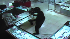 WATCH: Thieves break jewelry case with ax