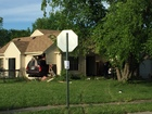 2 vehicles crash into house on NW side
