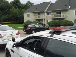 PHOTOS: Police investigating triple homicide