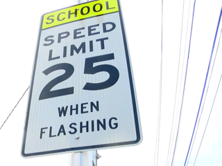 New school zone signs: The light is always right