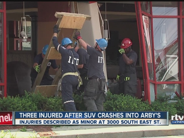 Three injured after SUV crashes into Arby's