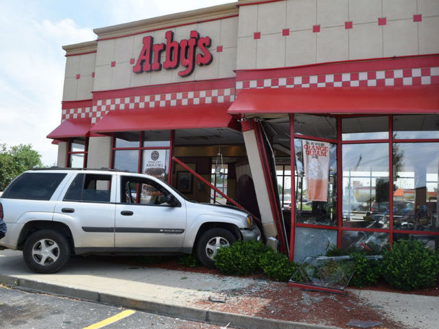SUV slams into Arby's, throwing 3 from booth