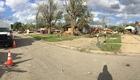 HS football players clean up tornado damage