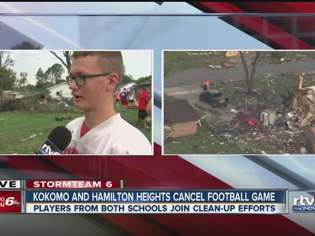 Kokomo and Hamilton high school football players clean up tornado damage