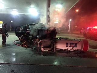 Vehicle strikes gas pump, causes fire