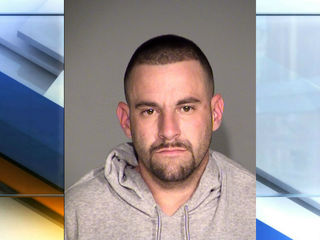 Man accused of robbing retired officer arrested