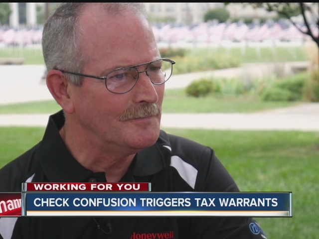 Check confusion triggers tax warrant