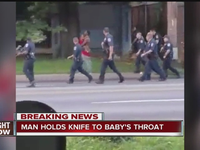 Man holds knife to baby's throat