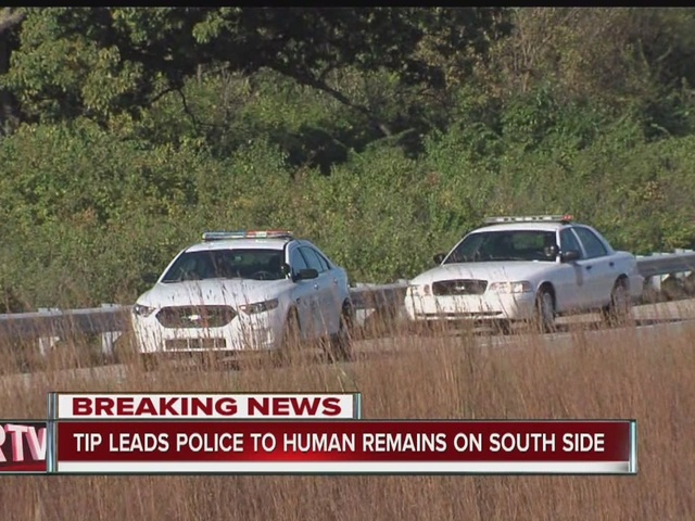 Police investigating possible human remains near interstate