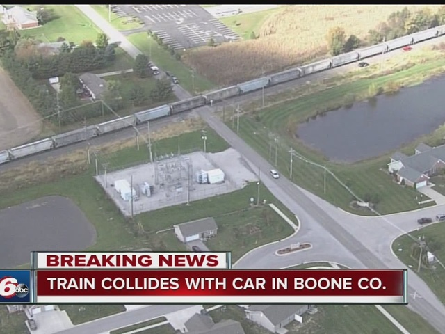 Train collides with car in Boone County