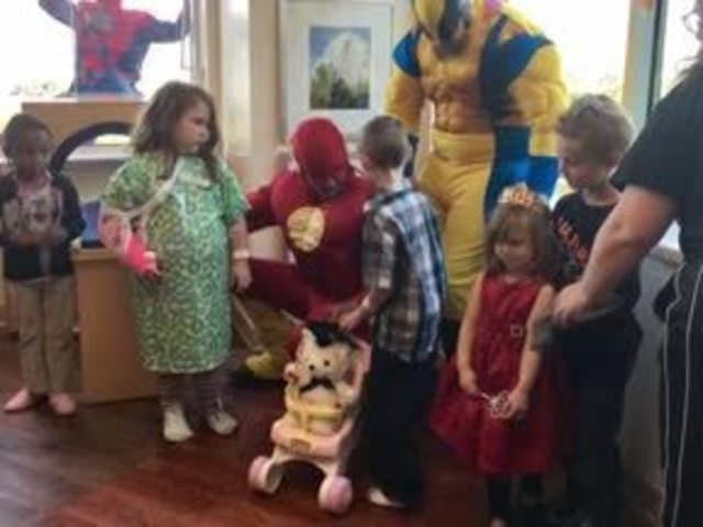 Superheroes scale down Riley Hospital to visit sick children