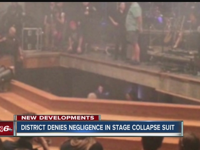 District denies negligence in stage collapse suit