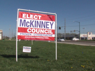 Candidate charged after opponent's signs stolen