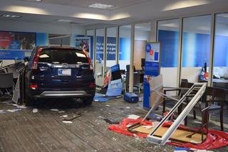 PHOTOS: SUV crashes into bank on Indy's NE side