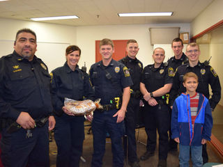 Boy spends day off baking muffins for cops