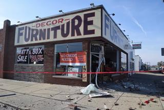 Driver plows into furniture store strikes sign pole on