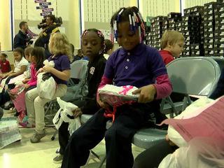 Students receive free new shoes for the holidays