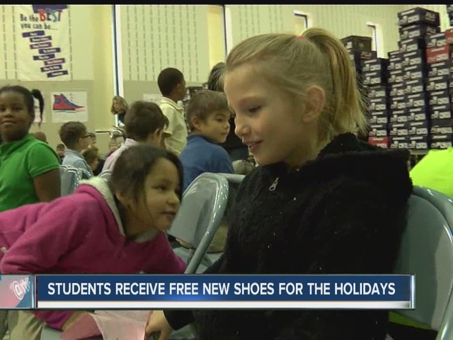 Students receive new shoes for holidays