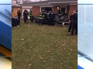 PD: Suspect, homeowner fight after car hits home