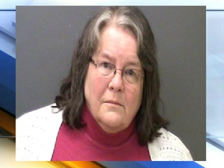 Trustee arrested for theft, official misconduct