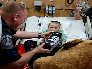 IMPD officers surprise boy at Riley Hospital