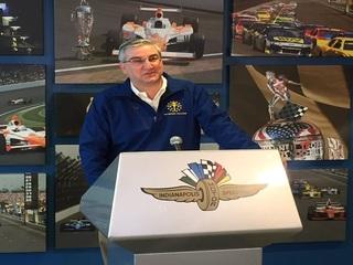 PHOTOS: Gov. Holcomb helps raise Indy 500 flag
