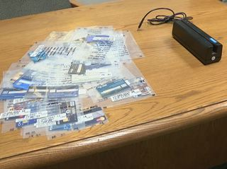 Two men arrested with credit card skimmer