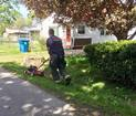 Fire department helps elderly woman mow lawn