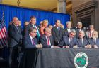 Gov. signs budget, road funding bills into law
