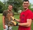 Bedford men find small gator in creek near home