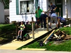 Firefighters repair 9-year-old's wheelchair ramp