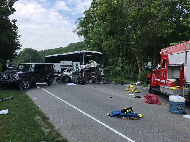 At least 3 killed when bus hits vehicle in construction zone