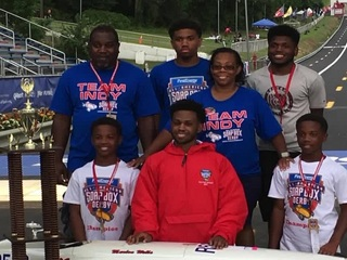 Teen becomes first black soap box derby champ