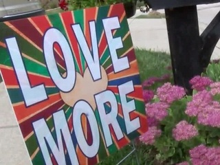 'Love More' signs spread message of hope
