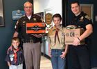 Brother Scouts give sweet surprise to officers