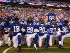 Colts kneel, lock arms in show of unity