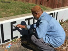 Man paints message about patriotism on N. side