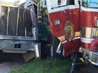 Driver charged after crash with fire truck