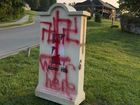 Vandals paint swastikas on southern Ind. signs