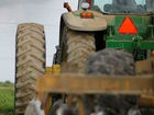 Man killed when tractor flips on top of him