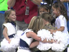 Military mom reunites with girls at Colts game