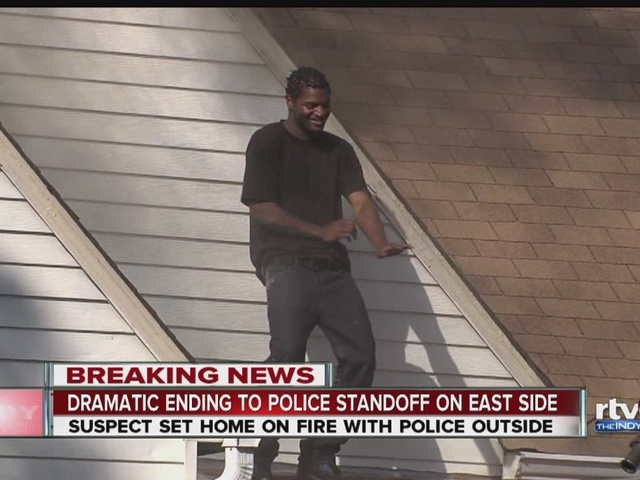 VIDEO: Man in police standoff dances on roof before being apprehended