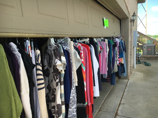 For A Large Clothing Sale Prop Your Garage Open Halfway And Hang Clothes From It Keeps Shoppers Digging Through Piles On Tables They Can See